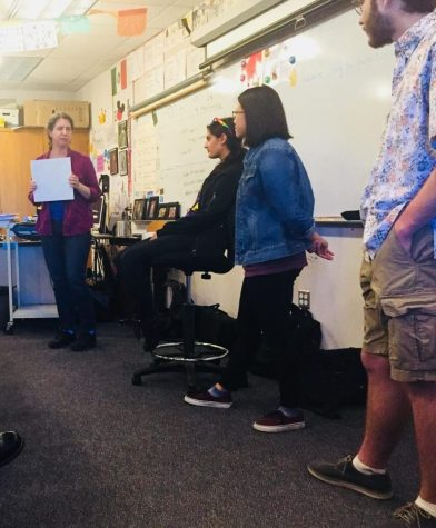Spanish teacher Joyce Fortune, advisor, and club officers Maya Tate, Natasha Lee, and Stephen Migdal (left to right) talk about their plans for National Coming Out Day on October 5th, hosted by the Gender Sexuality and Alliance club. Photo by Dhruvika Randad.