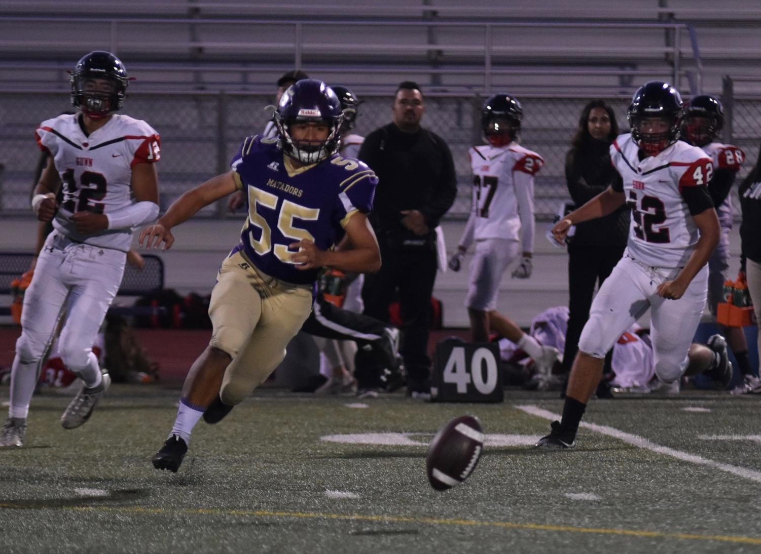 Senior Josh Garcia runs after the ball with Gunn players trailing closely behind