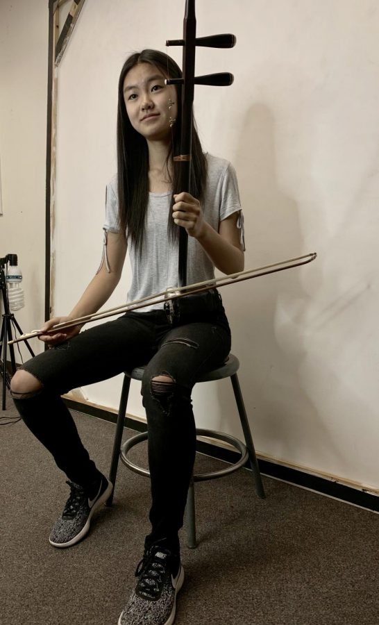Playing the Erhu