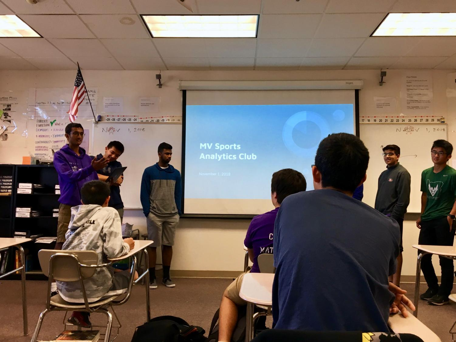 Senior Karthik Guruvayurappan (far left) introduces Sports Analytics Club at their first meeting on Nov. 1.  Photo by Roshan Fernandez.
