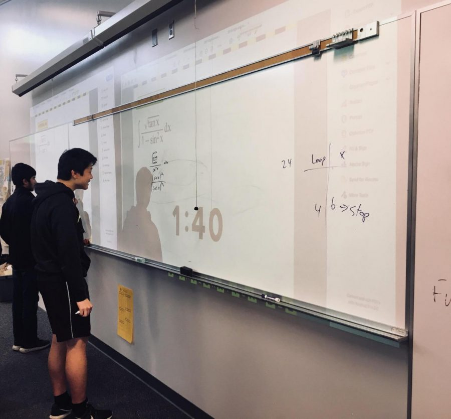 Sophomore Suraj Mathashery and Junior Jacob Nie go head to head in the final round of the integration bee. Photo by Iman Malik.
