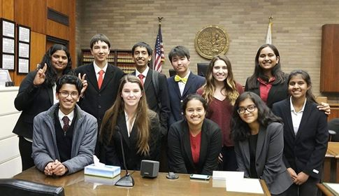 Members of Mock Trial gather to take a picture at one of their many competitions where they fight a fake case against other schools in front of a judge and a panel of attorneys. Photo used with permission of Irene McNelis