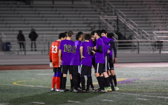 The MVHS boys varsity soccer team huddle up together just before the start of the game. Photo by Justine Ha.