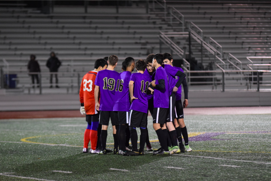 The+MVHS+boys+varsity+soccer+team+huddle+up+together+just+before+the+start+of+the+game.+Photo+by+Justine+Ha.+