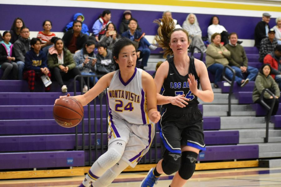 Senior Jessica Ji drives to the basket against a LAHS player. The team was able to use their quickness throughout the game in order to succeed on the offensive side. Photo by Anish Vasudevan.