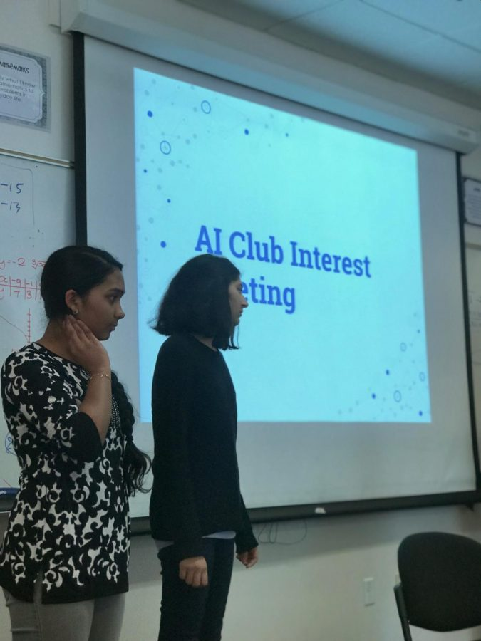 Sophomores+and+club+representatives+Eesha+Ramkumar+%28left%29+and+Ria+Doshi+%28right%29+prepare+to+give+a+presentation+on+what+AI+%28artificial+intelligence%29+club+has+to+offer.+