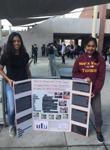 Sophomore Ramya Chamkeri and her partner stand with their Synopsys Science Fair Championship research project in the rally court. Chamkeri's project won an award in the annual Synopsys fair Championship. Photo courtesy of Ramya Chamkeri.