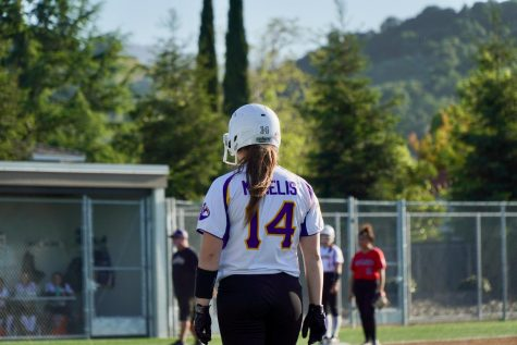 Senior Irene McNelis awaits an opportunity to run to second base after a successful base hit in the sixth inning. Photo by Justine Ha.
