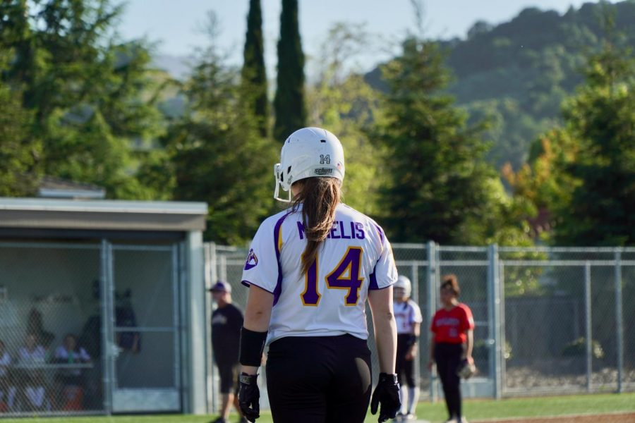 Senior+Irene+McNelis+awaits+an+opportunity+to+run+to+second+base+after+a+successful+base+hit+in+the+sixth+inning.+Photo+by+Justine+Ha.+