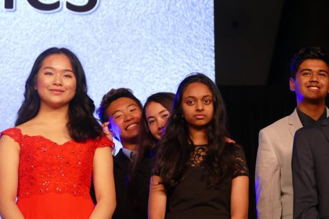 Junior Ethan Lin, junior Pratya Poosala, and freshman Marissa Jensen stand on stage as they wait for their first place to get announced. Photo courtesy by Ethan Lin