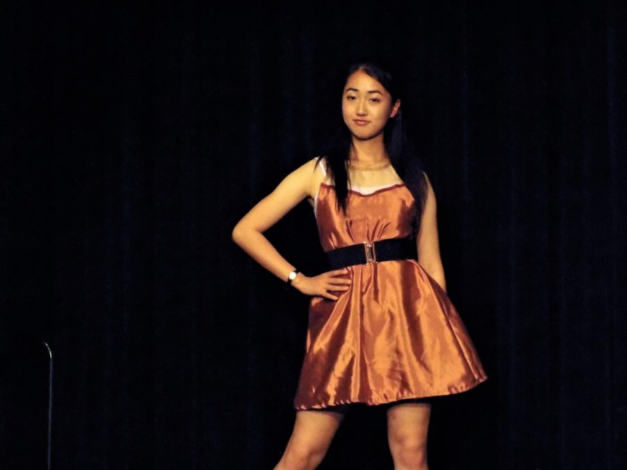 Senior Alisha Gao modeled for her first time. For Gao walking down the runway in heels was the hardest part. Photo by Sarah Young