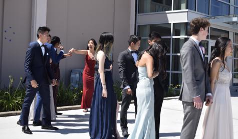 The six couples strutting down the Senior Ball Fashion Show