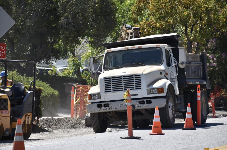 Construction vehicles crowd McClellan Road due to bike lane construction. Photo by Anish Vasudevan