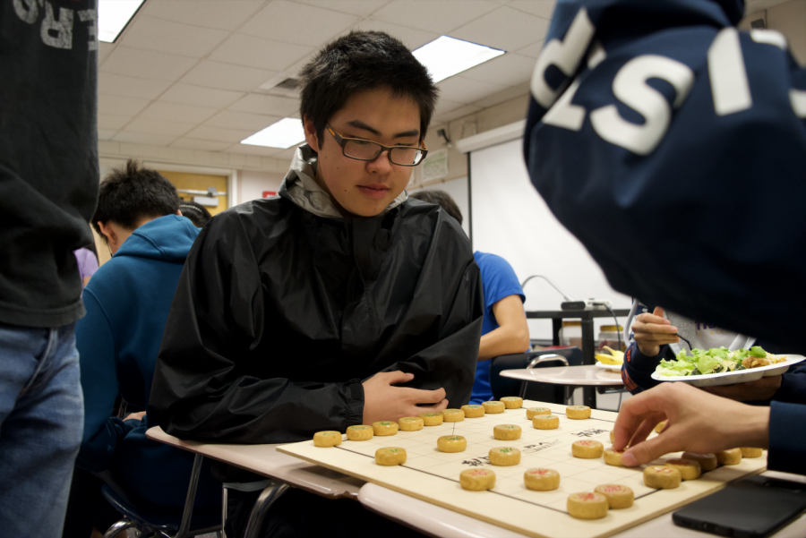 Senior+Jack+Tian+examines+his+opponent%27s+moves+during+a+match+of+Xiangqi.+Photo+by+Robert+Liu