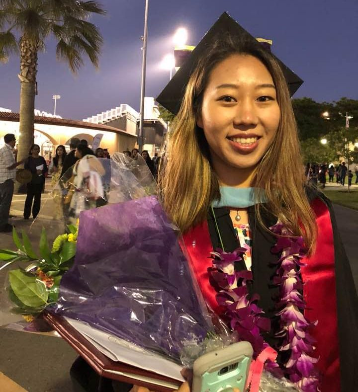 Physics and chemistry teacher Julie Choi poses at her graduation ceremony.