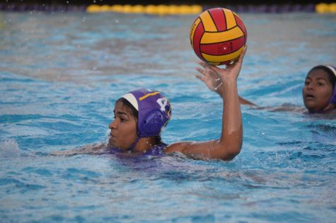 Junior Purva Gupta attempts to shoot the ball during the first quarter. Photo by Sophia Chen