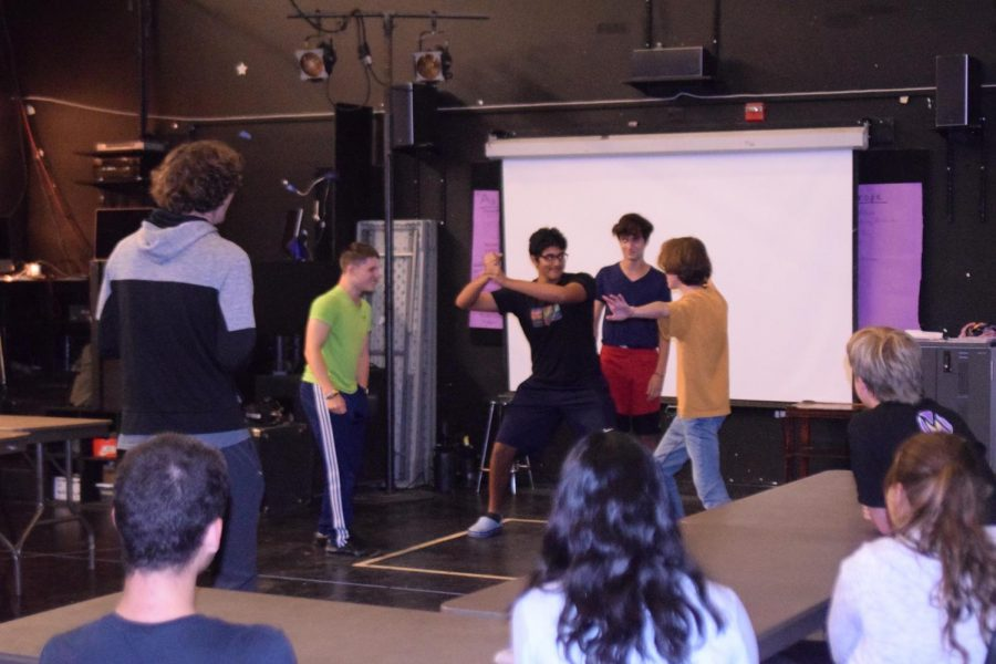 """Members make up a dramatic fight scene on the spot in a certain film style for another improv activity called """"Styles Replay."""" Photo by Vivian Jiang"""