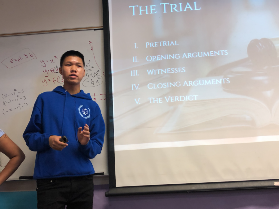 Co-president and senior Justin Feng began the interest meeting by discussing the various aspects of the mock trial, starting with the pretrial and ending with the verdict. Photo by Jayanti Jha