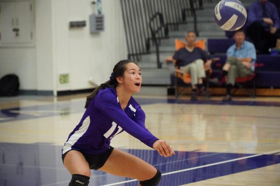 Freshman Miranda Shakouri bumps a ball early in the first set. Photo by Collin Qian