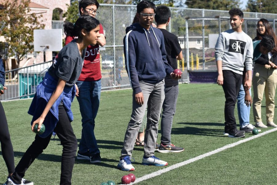 In Petanque players remain in a small circle while doing their throw, in this case French Honors Society club members played from behind a white line. Photo by Sarah Young.