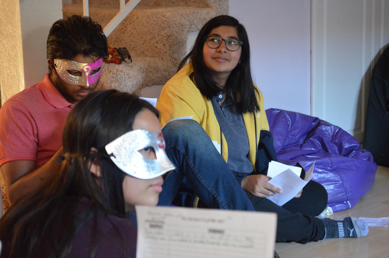 Junior Arya Das smiles while listening to junior Elene Pilpani's accusation during their confession round.