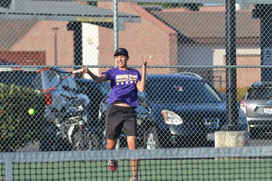 Junior Zara Fung returns a ball off of a hard hit volley