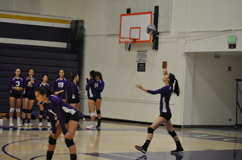Junior Yolanna Lu serves the ball in the third set of the game.