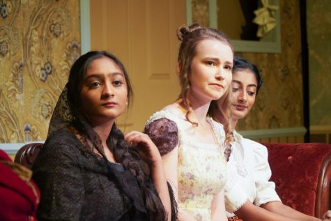 Fyokla Ivanovna (played by sophomore Shriya Dwivedi) and the Italian Rosebud (played by junior Dyuthy Ramachandran) sit alongside Agafya Tikhonovna (played by senior Naomi Hahn).