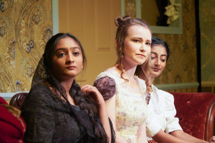 Fyokla Ivanovna (played by sophomore Shriya Dwivedi) and the Italian Rosebud (played by junior Dyuthy Ramachandran) sit alongside Agafya Tikhonovna (played by senior Naomi Hahn).