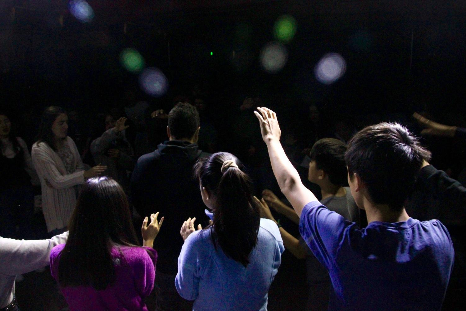 High school students gather around and pray for Valley Church youth pastor Craig Stephens at the tail end of the event.