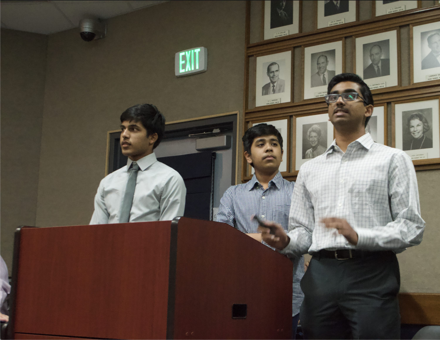 Sophomores and MV Microfinance officers Devin Gupta, Arnav Doshi, and Ojas Karnavat present their proposal to the FUHSD board to get their charity organization, Kiva, permanently approved for further use by the club throughout the year. Photo by Ishaani Dayal