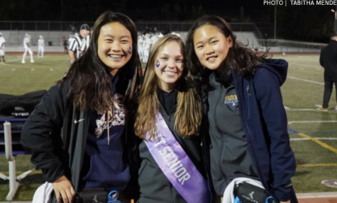 From left to right, junior Allison Leung, senior Hannah Risher and  junior Hannah Ho pose together at the football game against Homestead. Photo by Tabitha Mendez