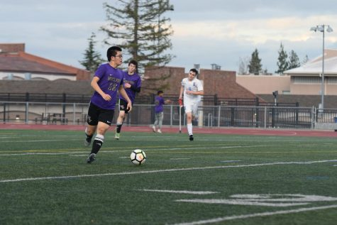 Junior Frank Liu looks up the field to try and pass the ball.