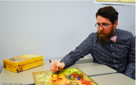 History teacher David Hartford playing the board game Stone Age in his classroom. Hartford tries to incorporate board games into his classroom when possible.