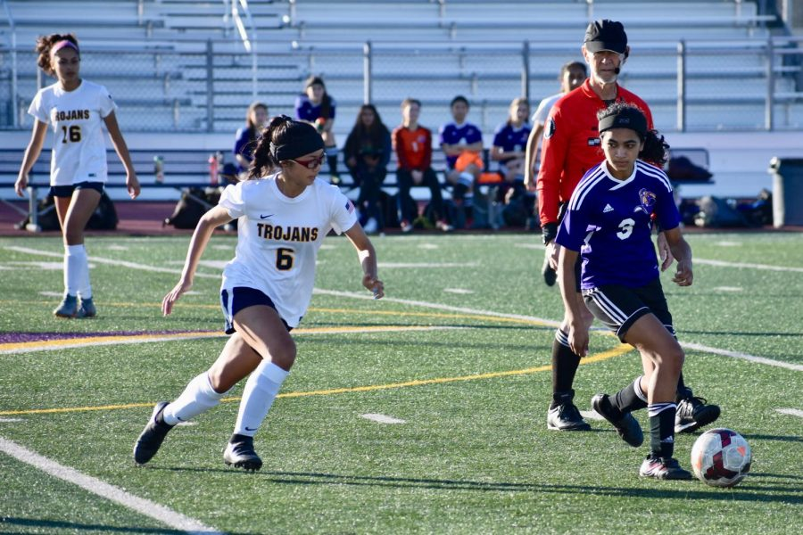 Freshman forward Diya Balakrishnan peers over her shoulder at the oncoming defender in order to anticipate her next move so that she maintains possession of the ball against Milpitas HS.