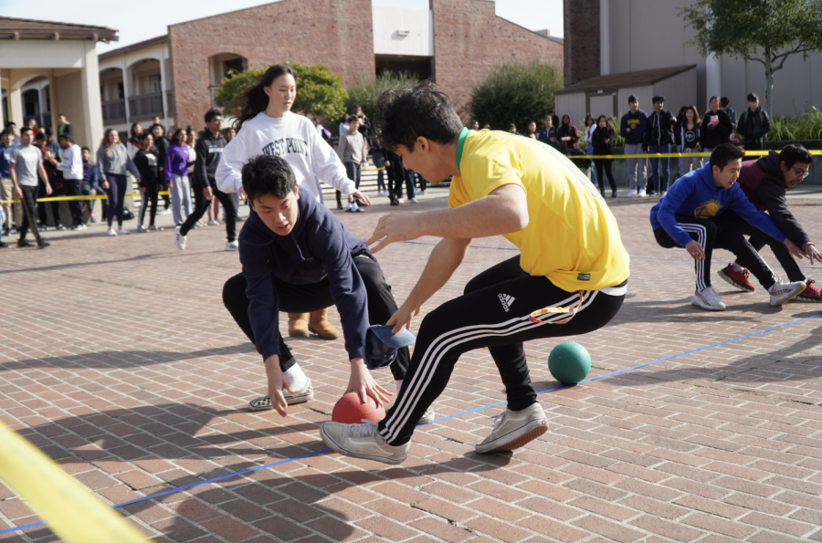 Senior Kamyar Moradi attempts to grab the ball from the middle of the court during the dodgeball finals. The game had two jailbreaks in which anyone from the competing class could join the game.