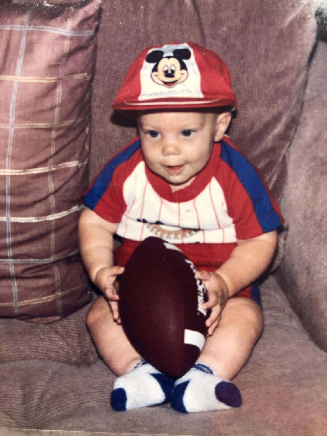A young Stiver poses with a football
