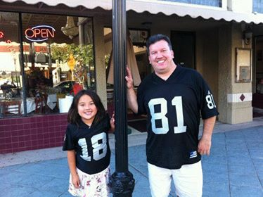 My dad and I when I was younger, matching in Raider gear often. We took this photo because our numbers were the opposite of each other.