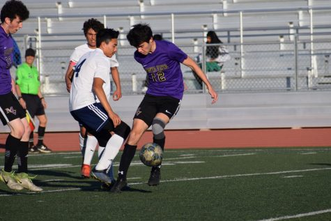 Sophomore Edin Kraja steals the ball from a MHS player.
