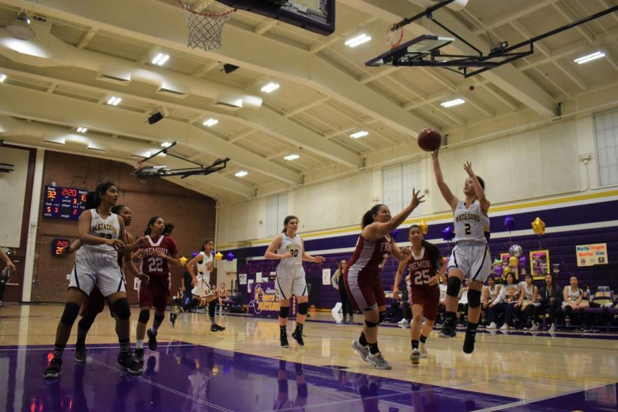 Junior Kelli Kosakura shoots a floater over FHS. Photo by Lance Tong