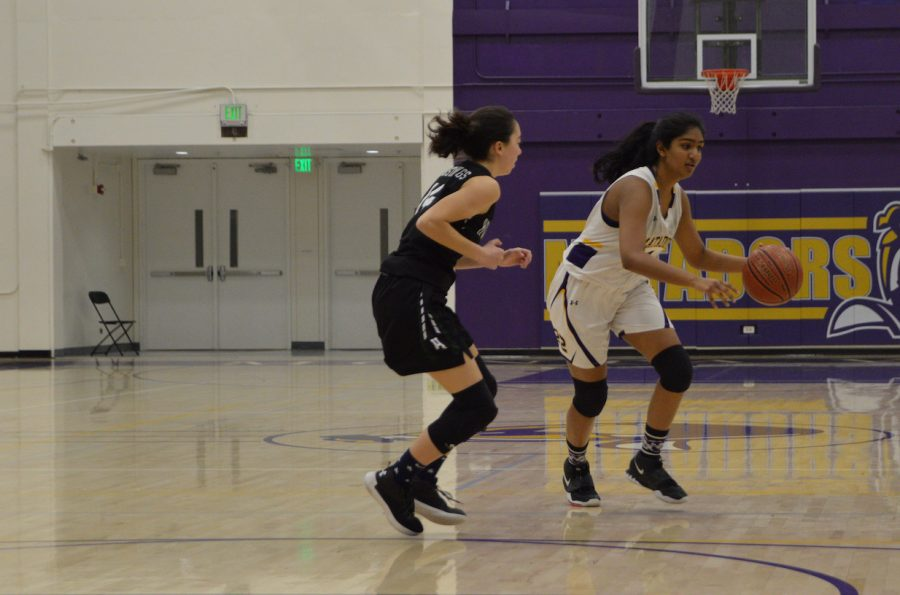 Sophomore Siri Adusumilli fakes her opponent out and dribbles around her to be able to pass to a teammate.