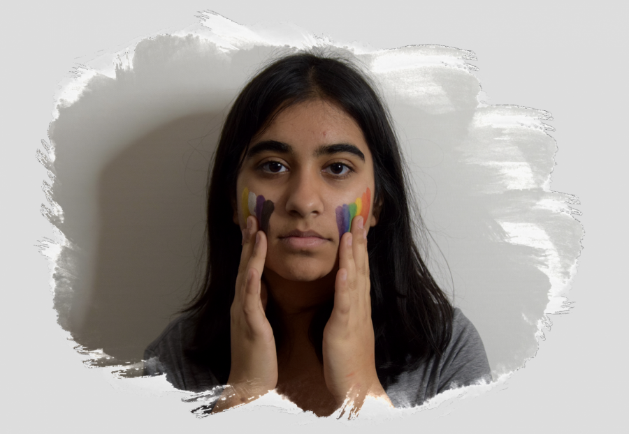 Sophomore+Anika+Sharma+drags+face+paint+down+their+face%2C+using+the+colors+of+the+non-binary+and+LGBTQ+flags.