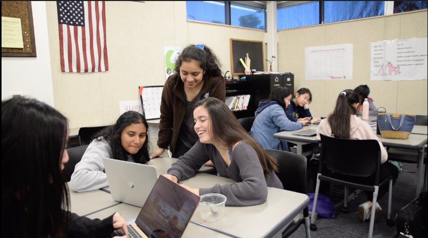 Girls Who Code members work on their projects.