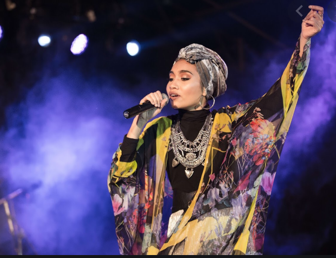 Yuna is a popular Malaysian singer who has collaborated with American artists like Usher and Tyler, The Creator.