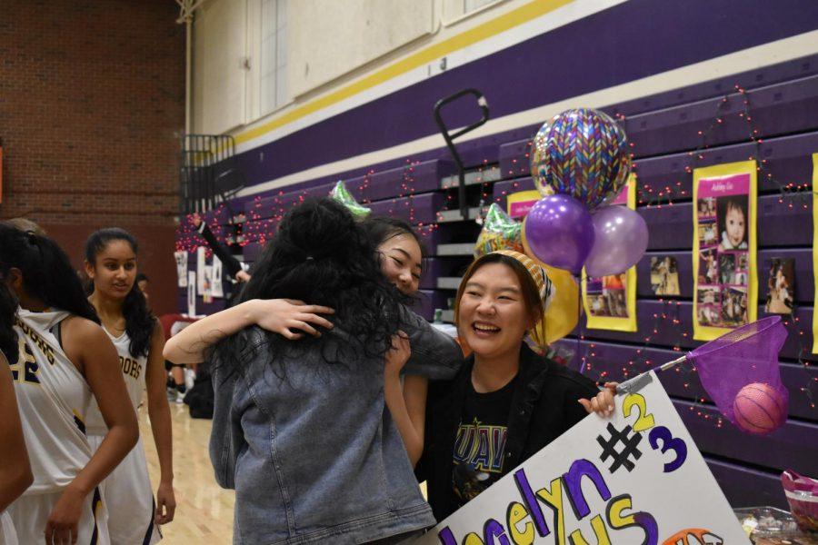 Senior Jocelyn Chang hugs her friends after an MVHS victory. Photo by Sreya Kumar