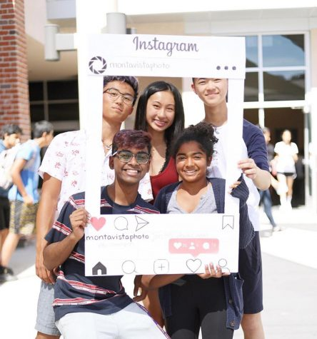 The 2019-20 MVHS Photography Club officer team poses for a photo with a poster board template of their Instagram account. Photo courtesy of Michelle Wang