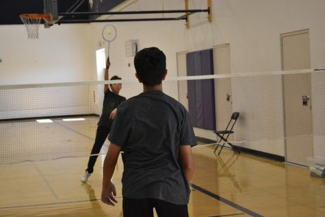 Freshman Samuel Choi returns a hit during Badminton Club's lunch open gym.