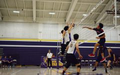 Senior Daniel Chang and junior Brandon Ng successfully block a spike by a Lynbrook HS player. The duo amounted for multiple blocks during the game.