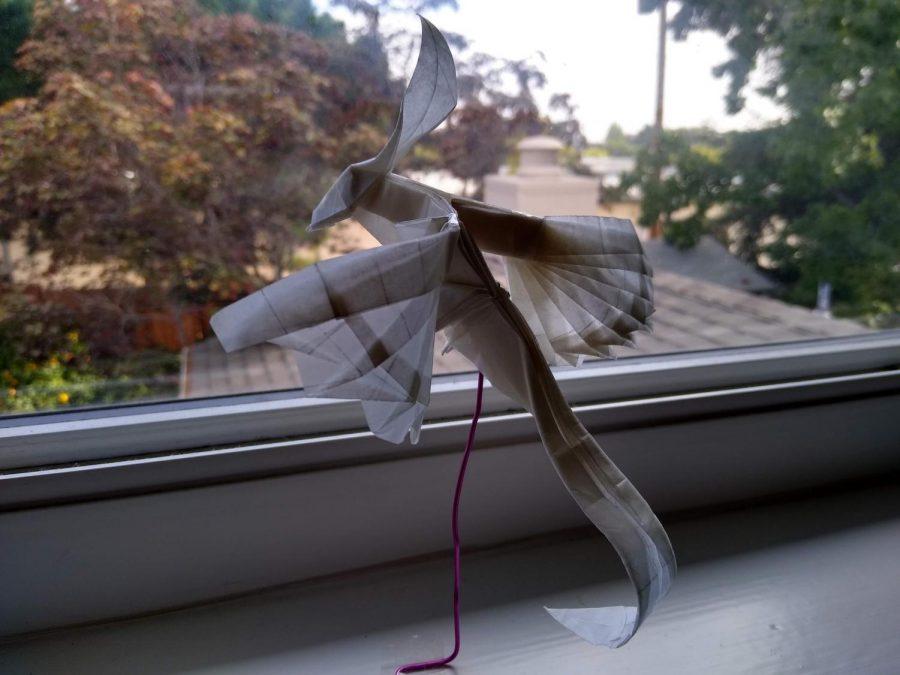 Senior Patricia Saito folded an origami phoenix model, created by Hongyi Wan.
