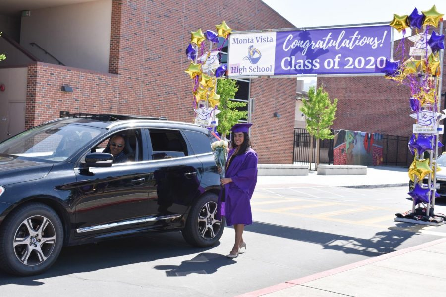 Senior Janani Kumar poses for a photo by her car.